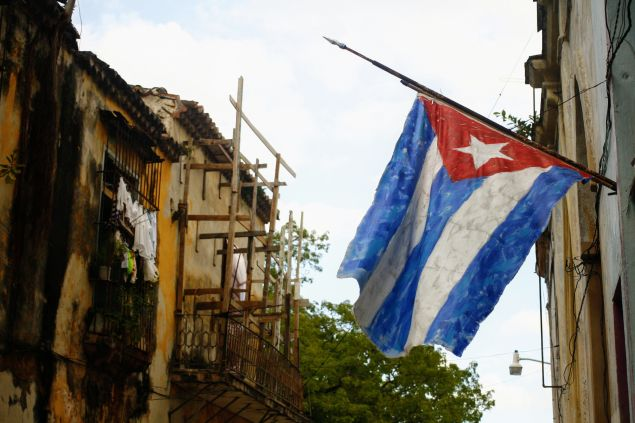 A handpainted Cuban flag outside the open door gallery and studio of an artist in Habana Vieja.