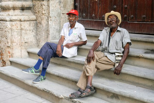 Local gentlemen on a Sunday afternoon, sitting on steps along the Catedral de San Cristóbal.