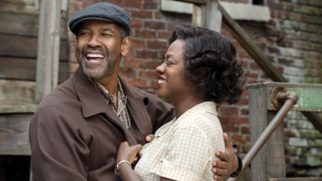 Denzel Washington as Troy Maxson and Viola Davis as Rose Maxson.