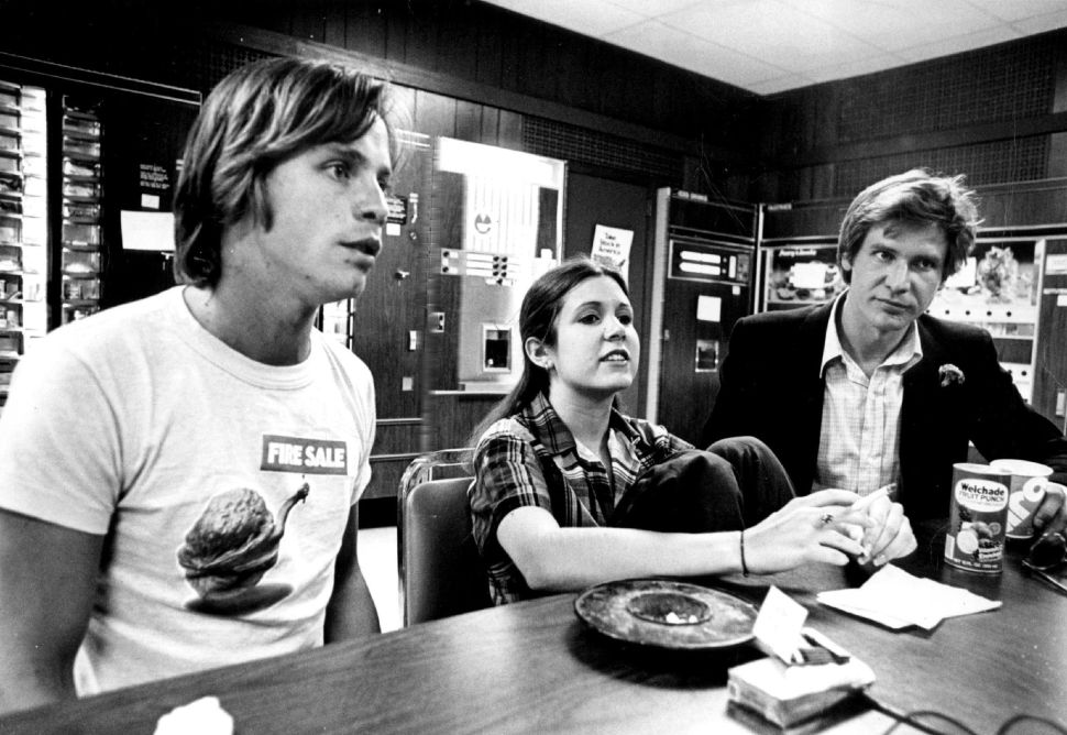 From left, Mark Hamill, Carrie Fisher and Harrison Ford.