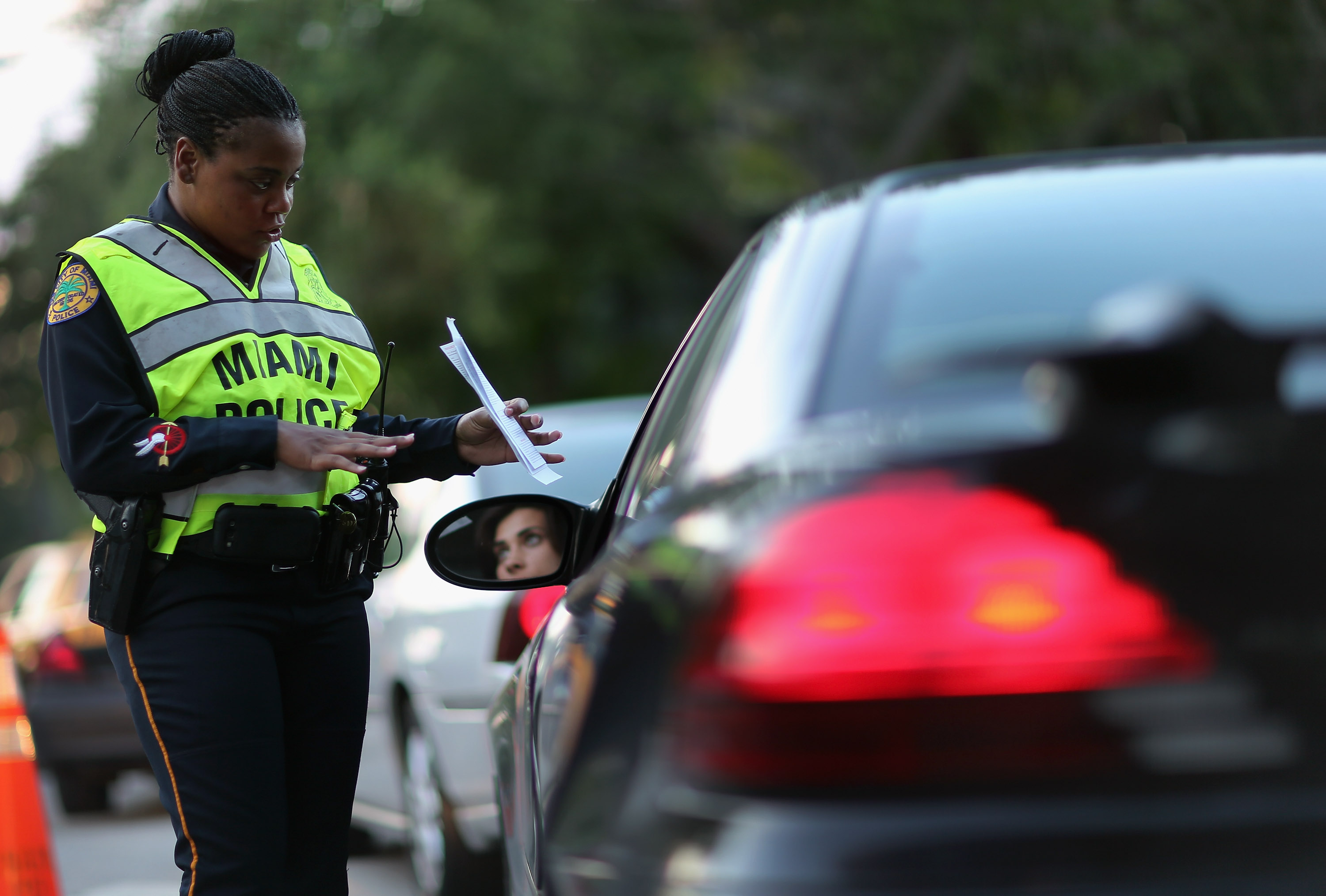 Police officer Lauren Miller speaks to a driver during a DUI checkpoint in Miami, Florida.