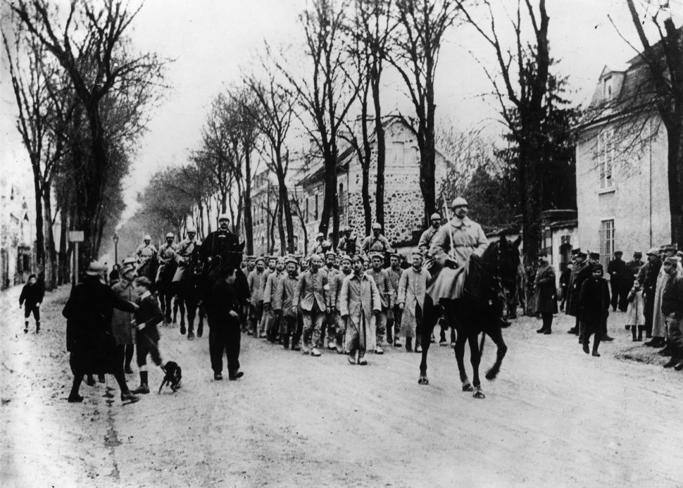 German prisoners captured at Verdun, are marched through the streets under mounted guard.