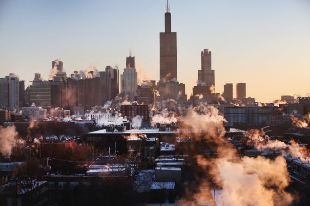 The sun rises behind the skyline as temperatures hovered around -10 degrees January 28, 2014 in Chicago, Illinois.