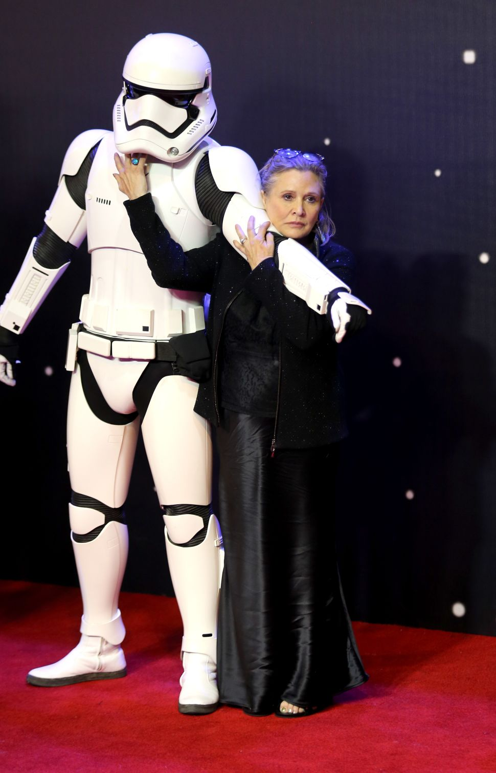 "LONDON, ENGLAND - DECEMBER 16: Carrie Fisher attends the European Premiere of ""Star Wars: The Force Awakens"" at Leicester Square on December 16, 2015 in London, England."