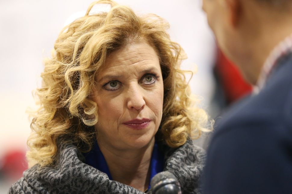U.S. Representative Debbie Wasserman Schultz speaks to a reporter before the democratic debate on December 19, 2015 in Manchester, New Hampshire.