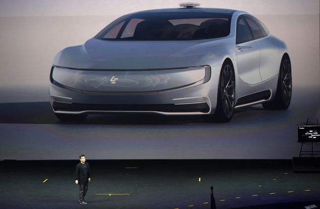 This photo taken on April 20, 2016 shows Chinese internet company LeEco Holdings Ltd unveils its internet electric battery driverless concept car 'LeSEE' during a launch event in Beijing. Chinese manufacturers and internet giants are in hot pursuit of their US counterparts in the race to design driverless cars, but the route to market is still littered with potholes. / AFP / STR / China OUT (Photo credit should read STR/AFP/Getty Images)