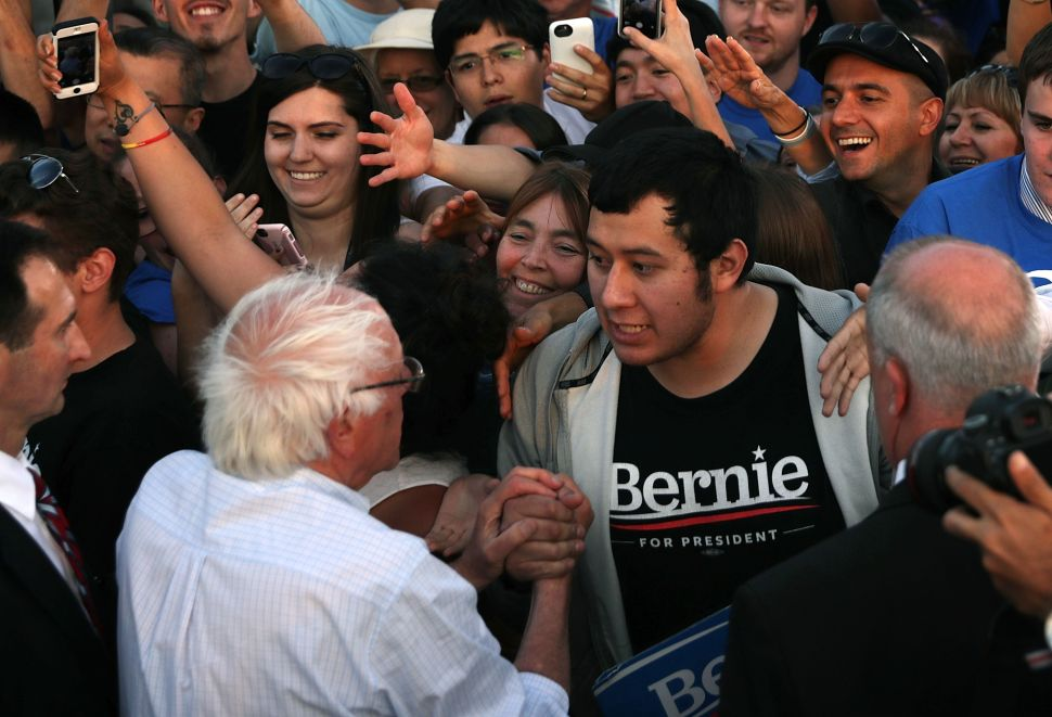 Sen. Bernie Sanders greets supporters during a rally near the Robert F. Kennedy Memorial Stadium June 9, 2016 in Washington, DC.