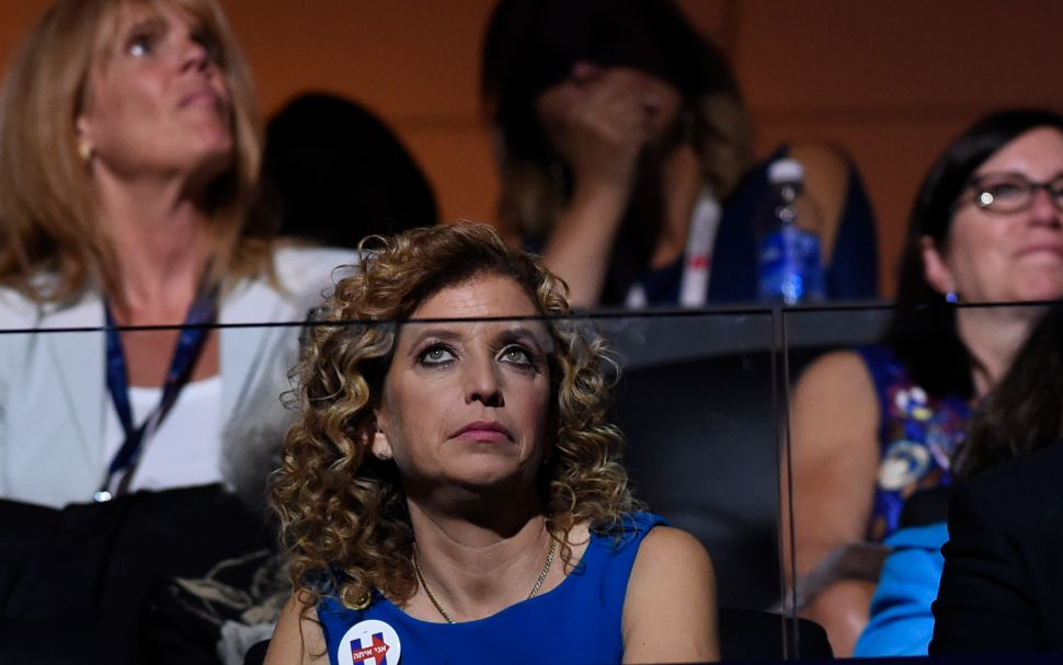 Former chair of the Democratic National Committee Debbie Wasserman Schultz listens to the biographical film presentation of Democratic presidential nominee Hillary Clinton during the fourth and final night of the Democratic National Convention at Wells Fargo Center on July 28, 2016 in Philadelphia, Pennsylvania.