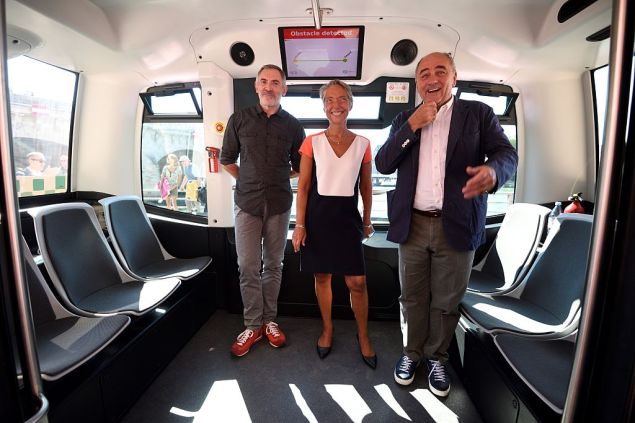 (From L) Director General of Easy Mile, Gilbert Gagnaire, CEO of the Paris Transport Authority RATP, Elisabeth Borne, and Paris Deputy mayor in charge of urbanism, architecture and projects, Jean-Louis Missika pose in a RATP electric-powered driverless EZ10 minibus, able to carry up to 12 passengers, as it carryies out its first test on the banks of the river Seine on September 24, 2016 in Paris. The RATP carries out its first test of a driverless minibus, in the hope that regular routes for the hi-tech vehicles will be up and running within two years. One of the self-driving shuttle buses, made by French hi-tech firm Easymile, run today along a special circuit in Paris on a pedestrianised street near the River Seine. / AFP / ERIC FEFERBERG (Photo credit should read ERIC FEFERBERG/AFP/Getty Images)