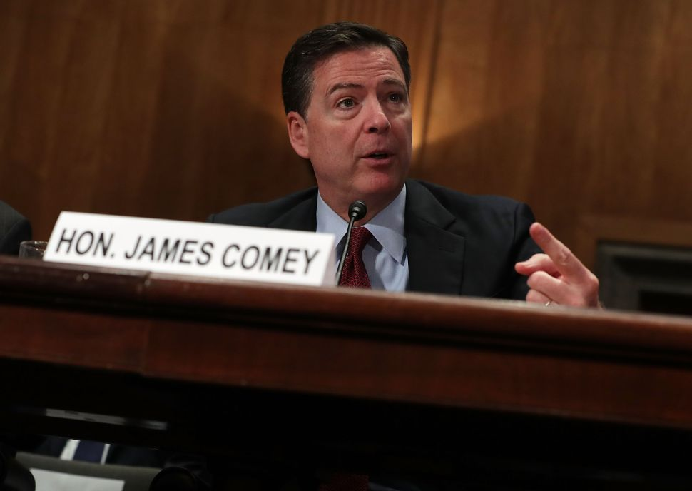 """WASHINGTON, DC - SEPTEMBER 27: FBI Director James Comey testifies during a hearing before the Senate Homeland Security and Government Affairs Committee September 27, 2016 on Capitol Hill in Washington, DC. The committee held a hearing on """"Fifteen Years After 9/11: Threats to the Homeland."""""""