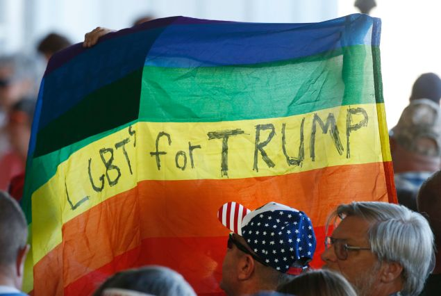 GRAND JUNCTION, CO - OCTOBER 18: Supporters hold up a gay pride flag for Republican presidential candidate Donald Trump on October 18, 2016 in Grand Junction Colorado. Trump is on his way to Las Vegas for the third and final presidential debate against Democratic rival Hillary Clinton. (Photo by George Frey/Getty Images