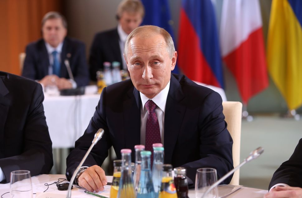 BERLIN, GERMANY - OCTOBER 19: Russian President Vladimir Putin attends a meeting to discuss the Ukrainian peace process at the German federal Chancellery on October 19, 2016 in Berlin, Germany. The leaders of Russia, Ukraine, France and Germany, known as the Normandy Four, met in Berlin to discuss implementation of the peace plan known as the Minsk Protocol, a roadmap for resolving the conflict in Ukraine after Russian forces invaded in 2014 and annexed the peninsula of Crimea. The United States has threatened renewed sanctions on Russia if the country did not either implement the plan in the coming months or arrive at a plan on how to do so.