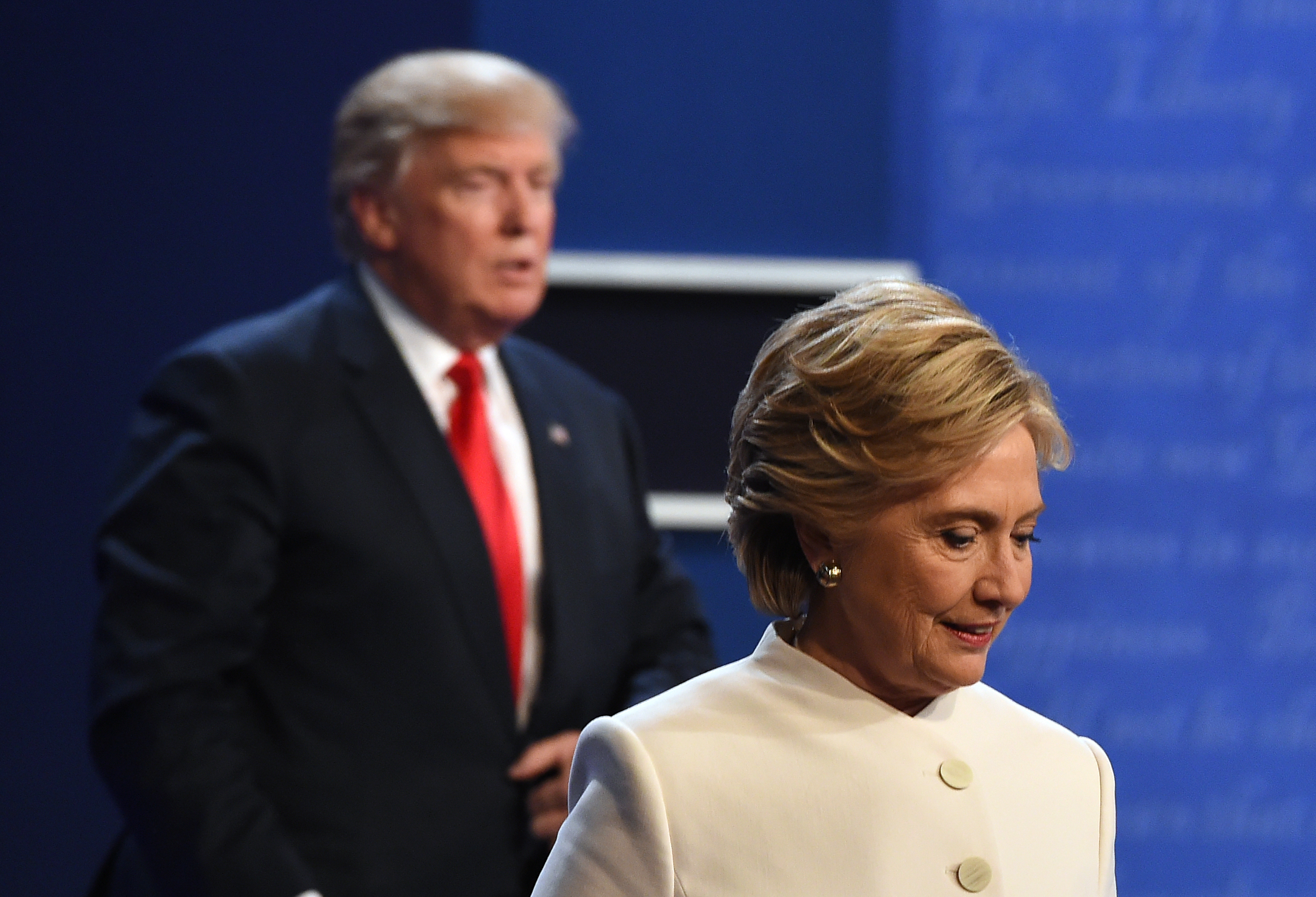 Hillary Clinton and Donald Trump walk off the stage after the final presidential debate at the Thomas & Mack Center on the campus of the University of Las Vegas in Las Vegas, Nevada on October 19, 2016.