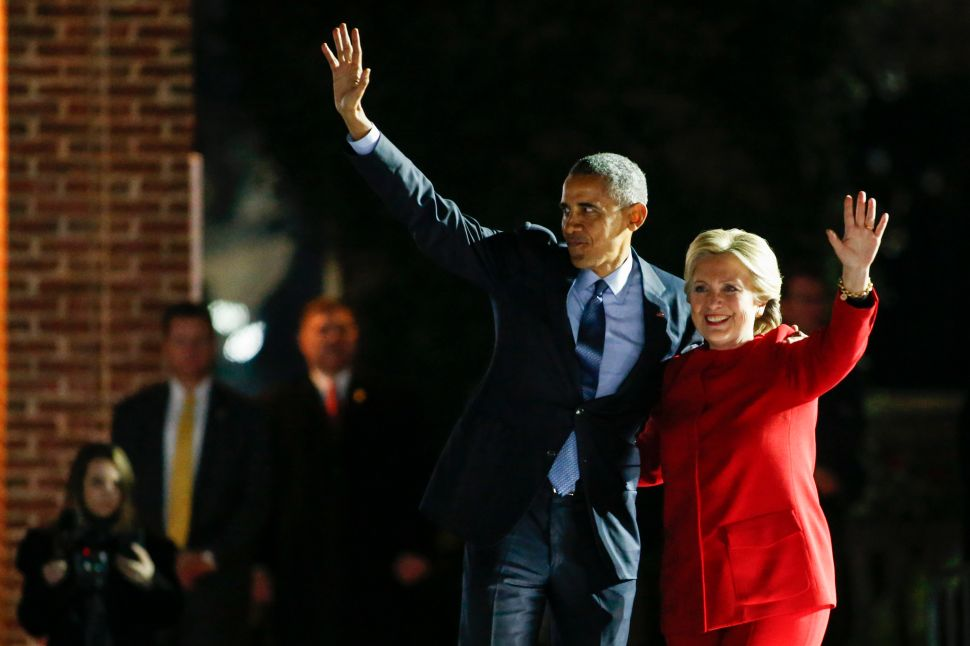 US Democratic presidential nominee Hillary Clinton and President Barack Obama wave to the crowd after a rally on the final night of the 2016 US presidential campaign at Independence Mall in Philadelphia, Pennsylvania, November 07, 2016.