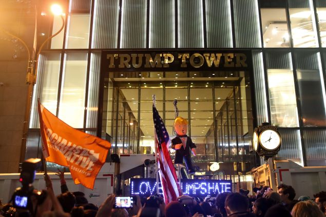 Hundreds of protestors rallying against Donald Trump gather outside of Trump Tower, November 9, 2016 in New York City.