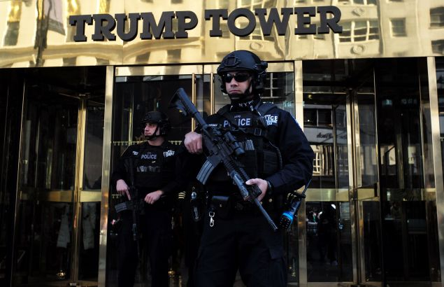 NYPD officers guard the entrance to Trump Tower.