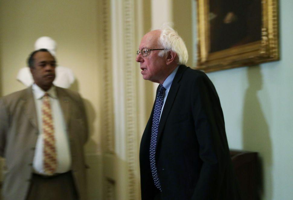 Sen. Bernie Sanders arrives at an election meeting of Senate Democrats at the Capitol November 16, 2016 in Washington, DC.