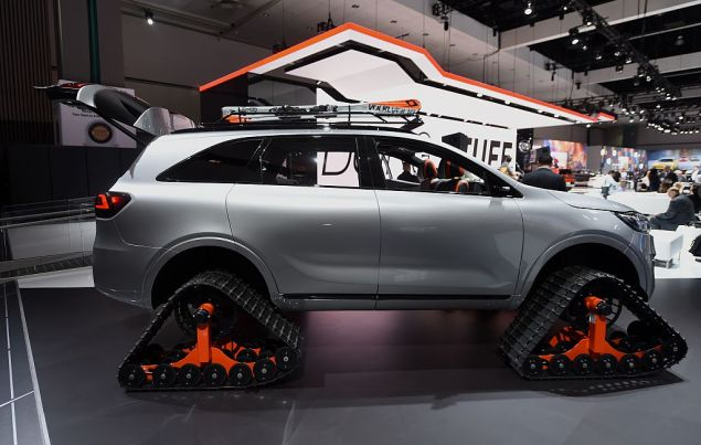 """A Kia Sorrento """"Ski Gondola"""" autonomous concept car with rubber track tires is on display during media preview days ahead of the public opening of the Los Angeles Auto Show, in Los Angeles, California, November 16, 2016. The LA Auto Show is open to the public from November 18 through November 27. / AFP / Robyn Beck (Photo credit should read ROBYN BECK/AFP/Getty Images)"""