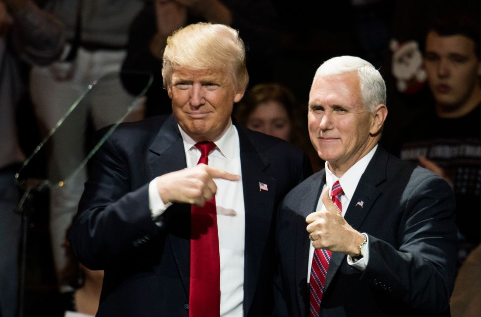 CINCINNATI, OH - DECEMBER 01: President-elect Donald Trump and Vice President-elect Mike Pence stand onstage together at U.S. Bank Arena on December 1, 2016 in Cincinnati, Ohio. Trump took time off from selecting the cabinet for his incoming administration to celebrate his victory in the general election.