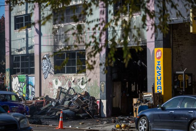 A warehouse is seen after it was destroyed by a fire, December 3, 2016 in Oakland, California.