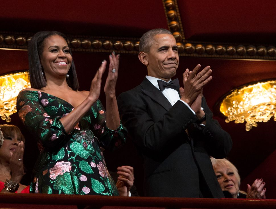 President Barack Obama and first lady Michelle Obama attend the Kennedy Center Honors show December 4, 2016 at the Kennedy Center in Washington, DC.