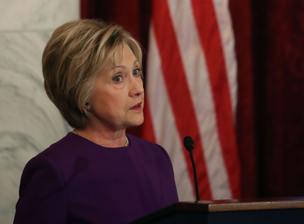 Former US Secretary of State, Hillary Clinton speaks during a portrait unveiling ceremony for outgoing Senate Minority Leader Harry Reid, on Capitol Hill December 8, 2016 in Washington, DC.