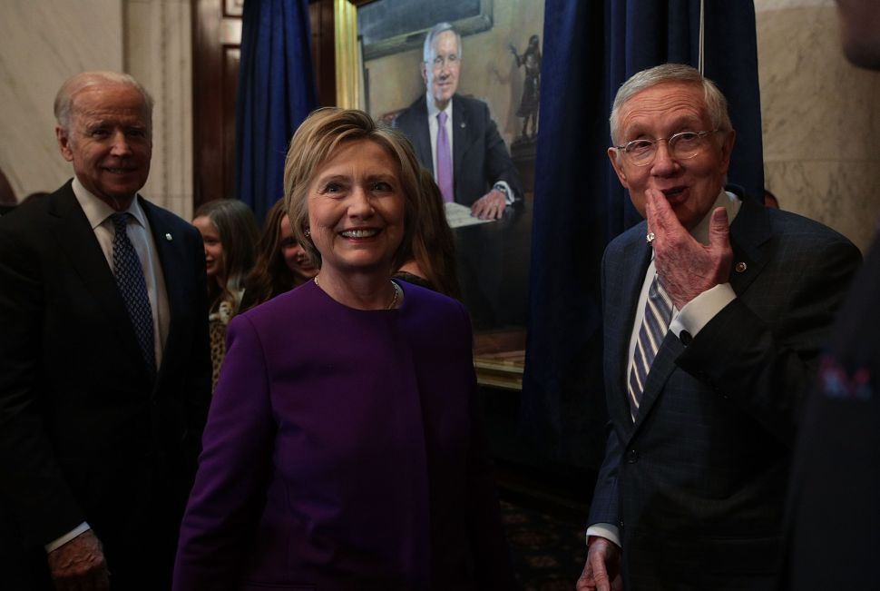 U.S. Senate Minority Leader Sen. Harry Reid , former Secretary of State Hillary Clinton and Vice President Joseph Biden during Reid's leadership portrait unveiling ceremony December 8, 2016 on Capitol Hill in Washington, DC.