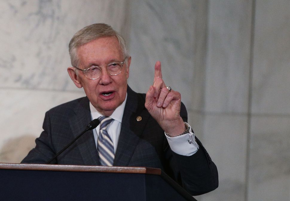 Senate Minority Leader Sen. Harry Reid speaks during his leadership portrait unveiling ceremony December 8, 2016 on Capitol Hill in Washington, DC.