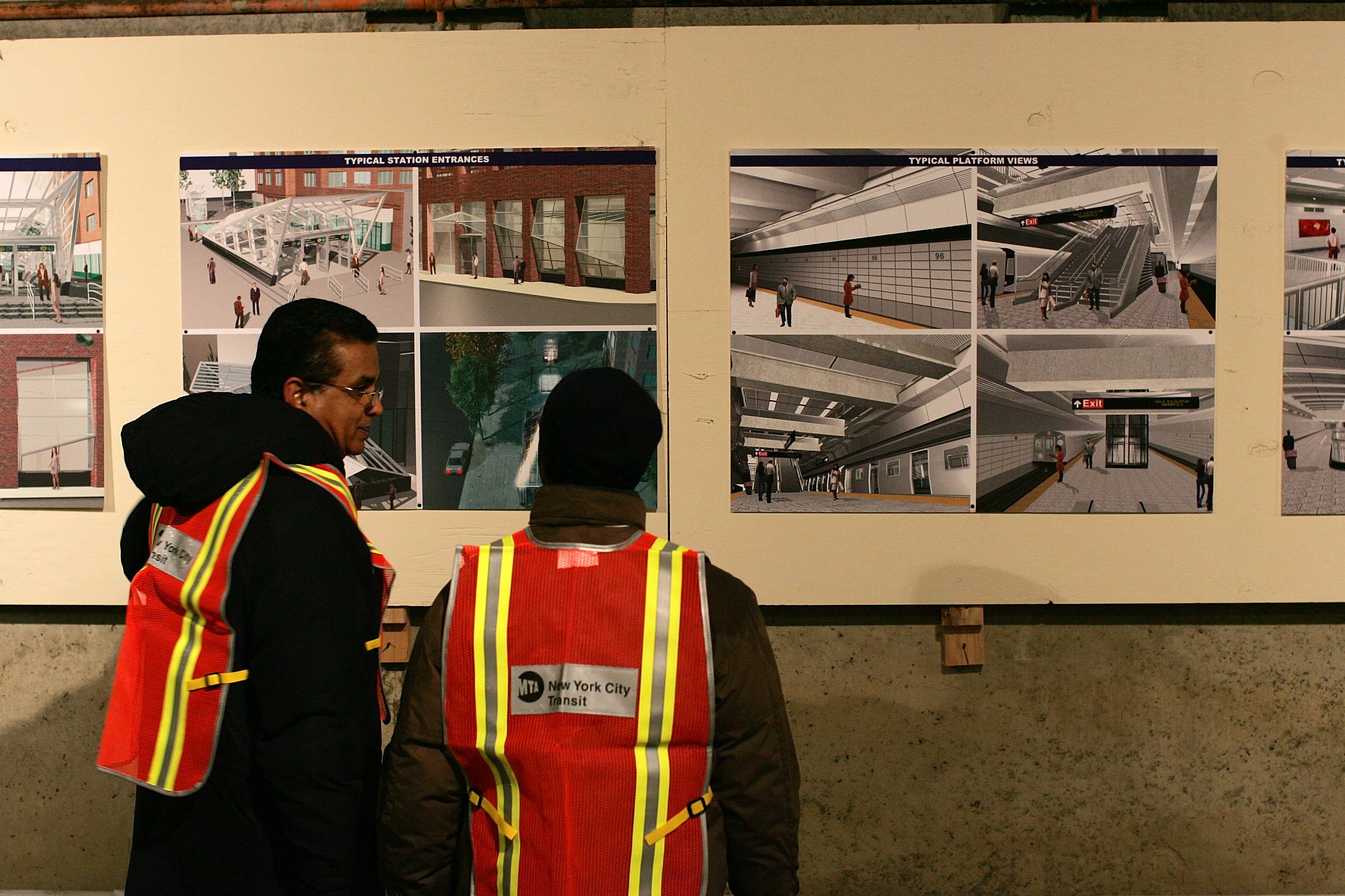 NEW YORK - APRIL 12: Metropolitan Transportation Authority (MTA) workers look at proposed designs for a completed subway platform in an underground tunnel for the long-proposed 2nd Avenue subway line April 12, 2007 in New York City. A groundbreaking ceremony was held for the line, one of numerous since the project was first proposed 80 years ago. The first phase of the line is scheduled to be completed in 2013, running from 96th Street to 63rd Street at a cost of $3.8 billion. Upon completion, line would add 8.5 miles of tracks and carry five million riders on weekdays in four of New York City's five boroughs.