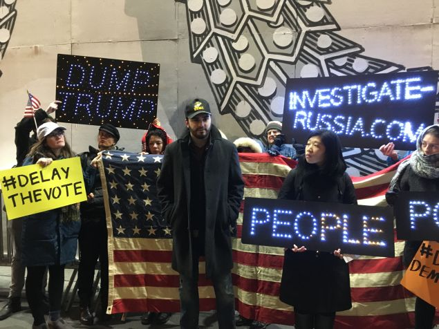 Activists call on the Electoral College to delay their vote scheduled for Monday.