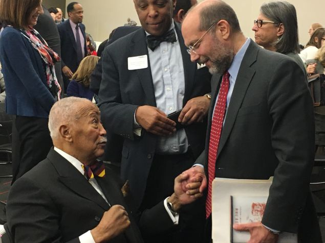 Former Mayor David Dinkins, left, and Human Resources Administration Commissioner Steve Banks, right, chat after Banks' speech at the New York Law School.