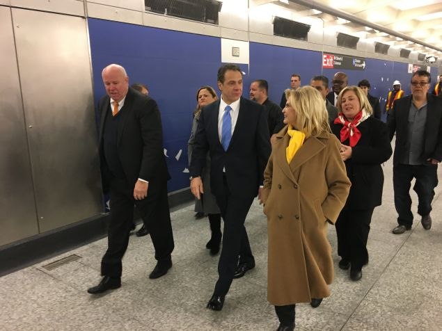 Elected officials walking through the 96th Street Station of the Second Avenue Subway line.