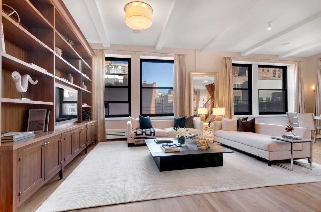 The pristine duplex is on the tenth and eleventh floors of Mercer House.