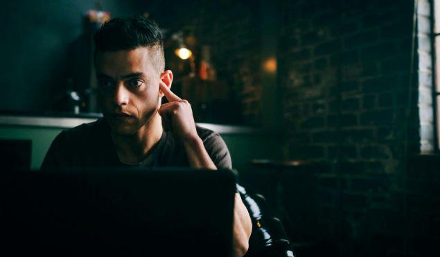 Rami Malek as Elliot Alderson.