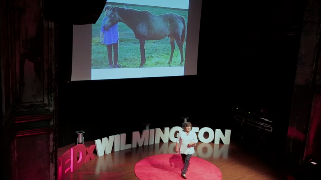 """Tatz Chernoff givin a Ted Talk titled """"How horses heal, transform, and empower"""" at TedX Wilmington."""