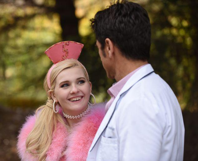 Abigail Breslin as Chanel #5 and John Stamos as Dr. Brock Holt.