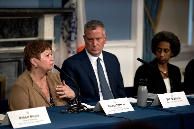 Former Administration for Children's Services Commissioner Gladys Carrión speaks as Mayor Bill de Blasio and Deputy Mayor Herminia Palacio look on.