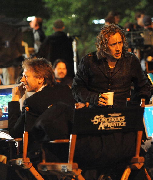 """Producer Jerry Bruckheimer and actor Nicolas Cage on location for """"The Sorcerer's Apprentice"""" in New York City.  (Photo by Bobby Bank/WireImage)"""
