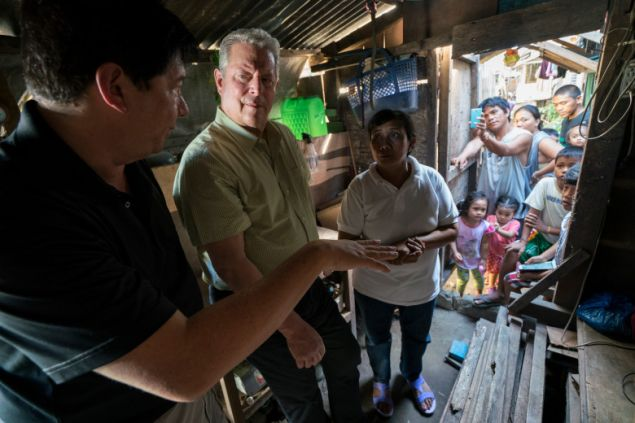 Al Gore with former Mayor of Tacloban City Alfred Romualdez and Typhoon Haiyan survivor Demi Raya, in the Philippines, from An Inconvenient Sequel: Truth to Power