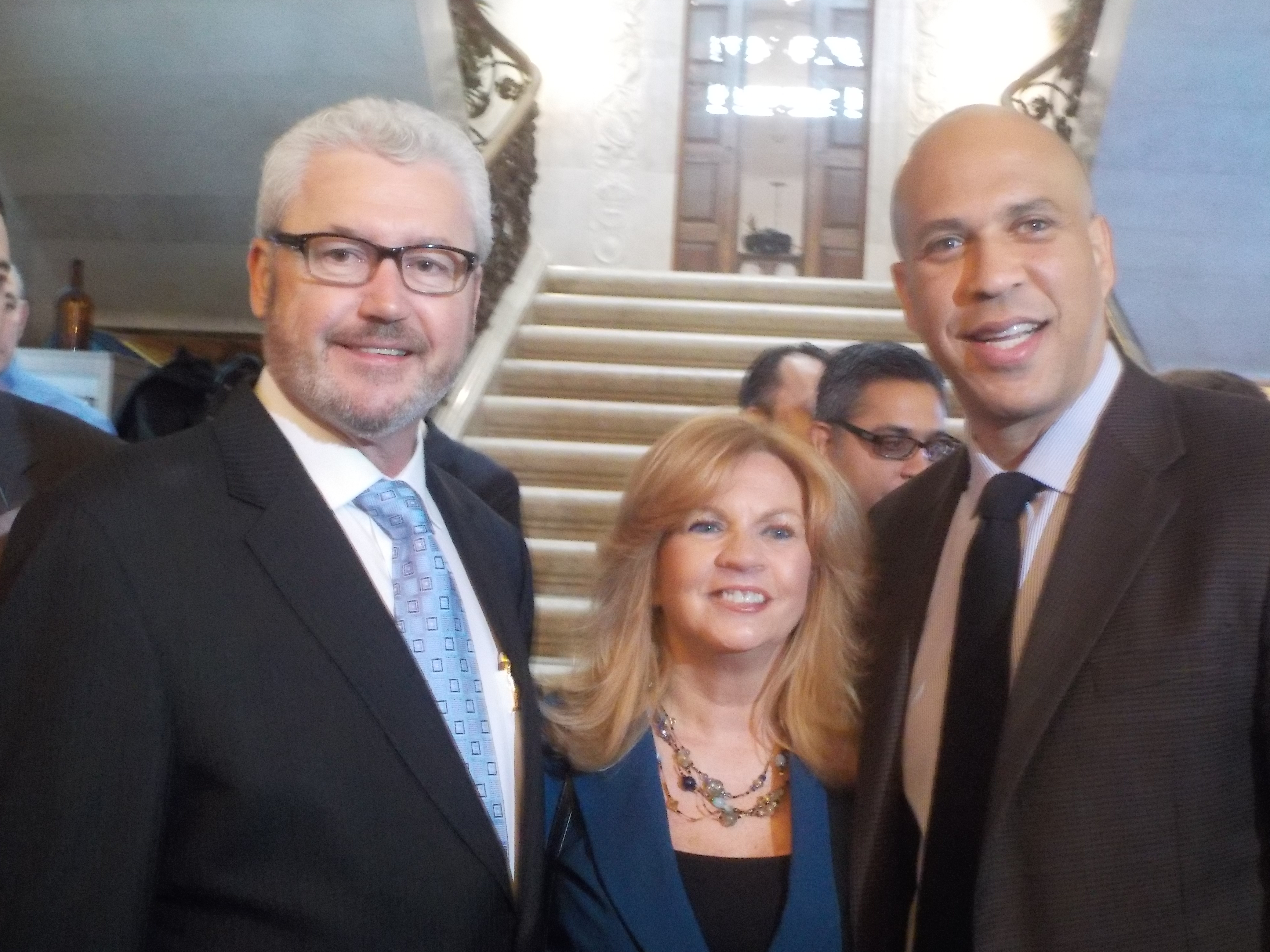Morristown Mayor Tim Dougherty (left) announced his candidacy on Monday. Pictured with his wife, Mary, and U.S. Senator Cory Booker.