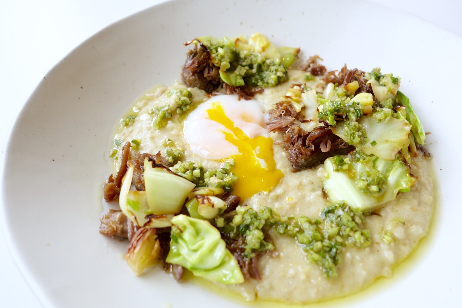 Kismet's freekeh polenta is served with lamb, green chiles, greens and a soft-boiled egg.