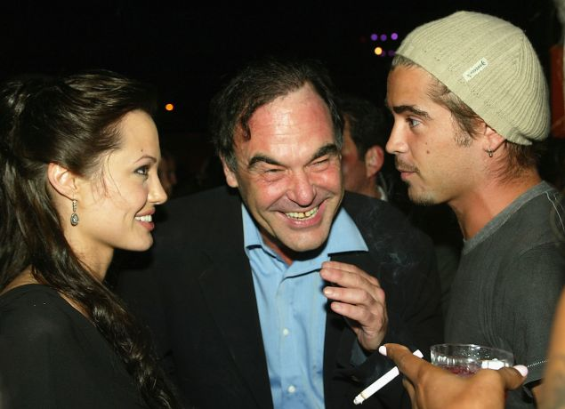 Actress Angelina Jolie, Oliver Stone and Colin Farrell, sharing a private moment after Cradle of Life premiere.