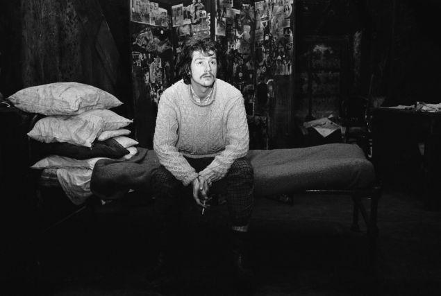 John Hurt, 1966. English actor John Hurt sitting on a bed at the Garrick Theatre.