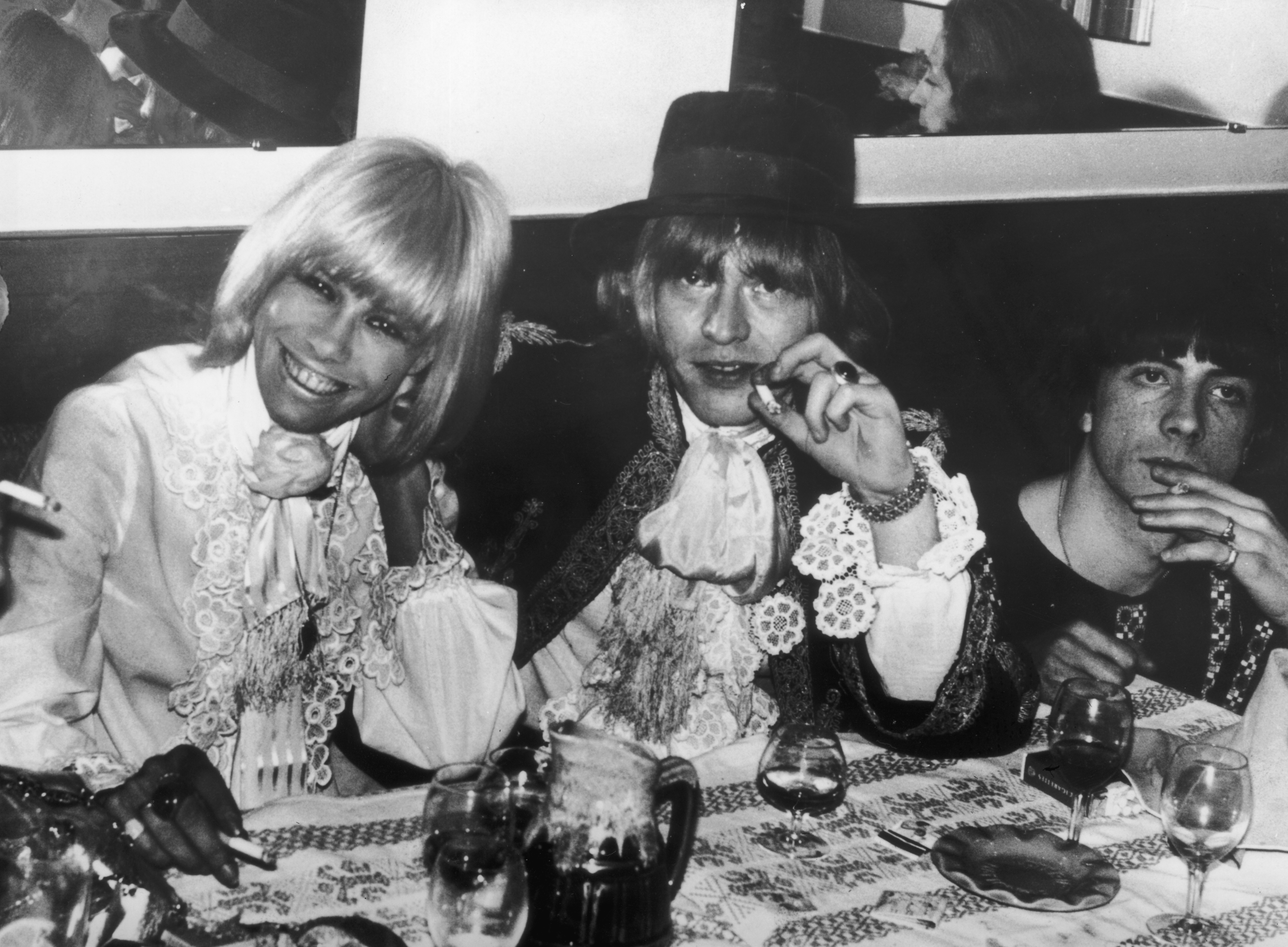 Anita Pallenberg and Brian Jones attending a party in Cannes during the film festival.