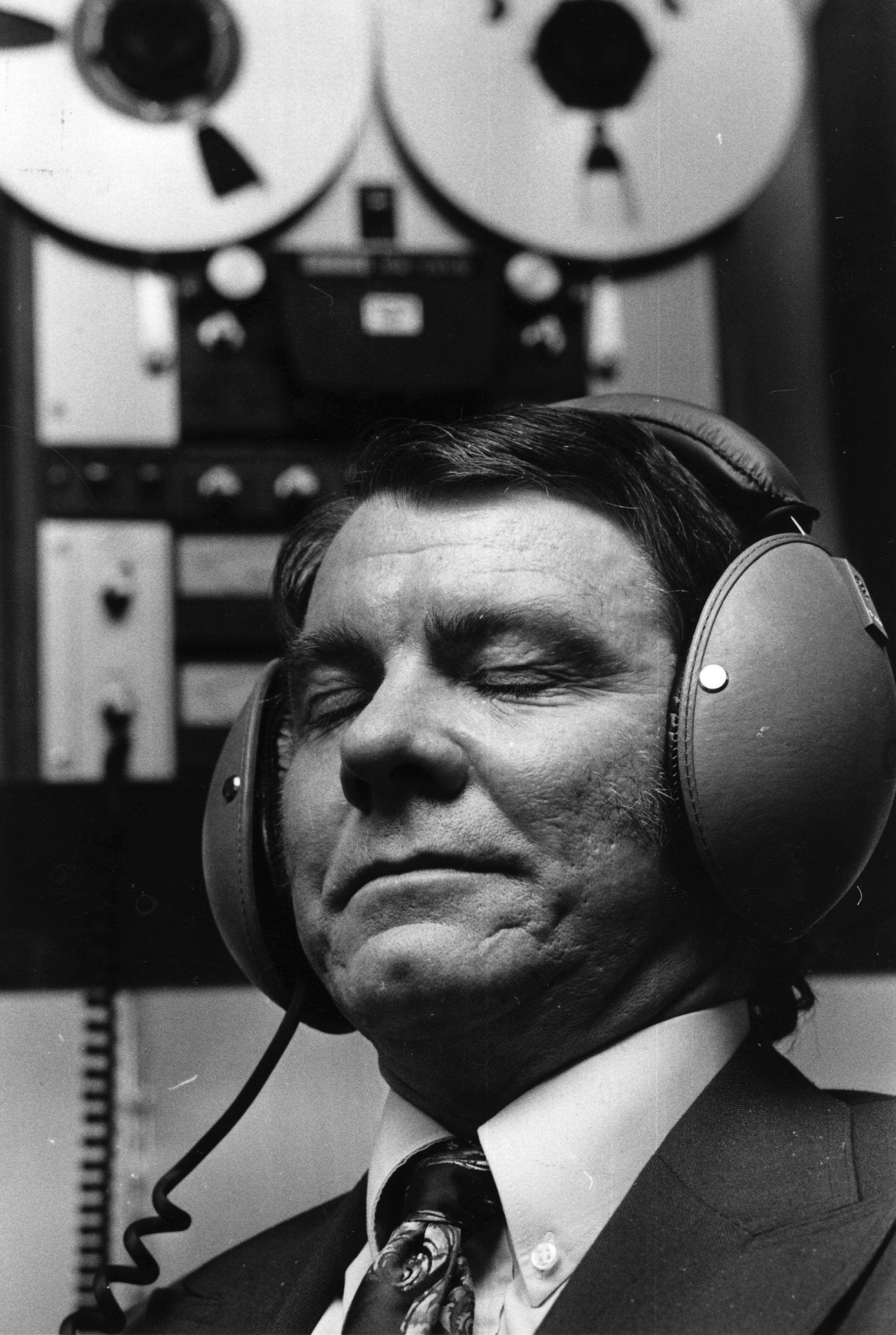 18th April 1974: A man listens with headphones during a tape hi-fi (high fidelity) demonstration.