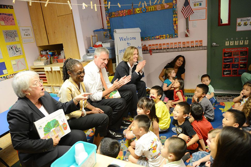 NEW YORK, NY - SEPTEMBER 4: New York Mayor Bill de Blasio (Center-R), along with schools Chancellor Carmen Farina (L), First Lady Chirlane McCray (Center-L), and Queens Borough President Melinda Katz (R), visits Pre-K classes at Home Sweet Home Children's School in Queens on the first day of NYC public schools, September 4, 2014 in the Queens borough of New York City. New York Mayor Bill de Blasio is touring universal pre-kindergarten programs throughout the city. (Photo by Susan Watts-Pool/Getty Images)