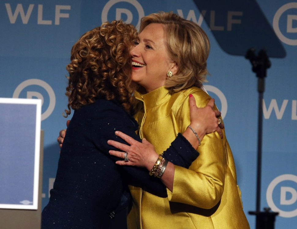 Hillary Clinton gets a hug from Rep. Debbie Wasserman Schultz.