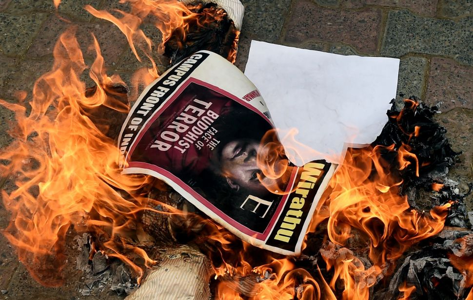 Indian protesters burn the image Ashin Wirathu, a hardline Buddhist monk in Myanmar, as they rally in support of Rohingya Muslims in Myanmar during a protest in New Delhi.