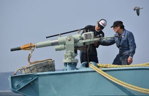 Crew of a whaling ship check a whaling gun or harpoon before departure at Ayukawa port in Ishinomaki City on April 26, 2014. A Japanese whaling fleet left port on April 26 under tight security in the first hunt since the UN's top court last month ordered Tokyo to stop killing whales in the Antarctic. AFP PHOTO / KAZUHIRO NOGI (Photo credit should read KAZUHIRO NOGI/AFP/Getty Images)