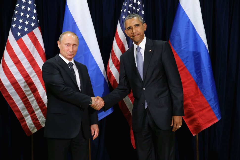 NEW YORK, NY - SEPTEMBER 28: (AFP OUT) Russian President Vladimir Putin (L) and U.S. President Barack Obama shake hands for the cameras before the start of a bilateral meeting at the United Nations headquarters September 28, 2015 in New York City. Putin and Obama are in New York City to attend the 70th anniversary general assembly meetings.